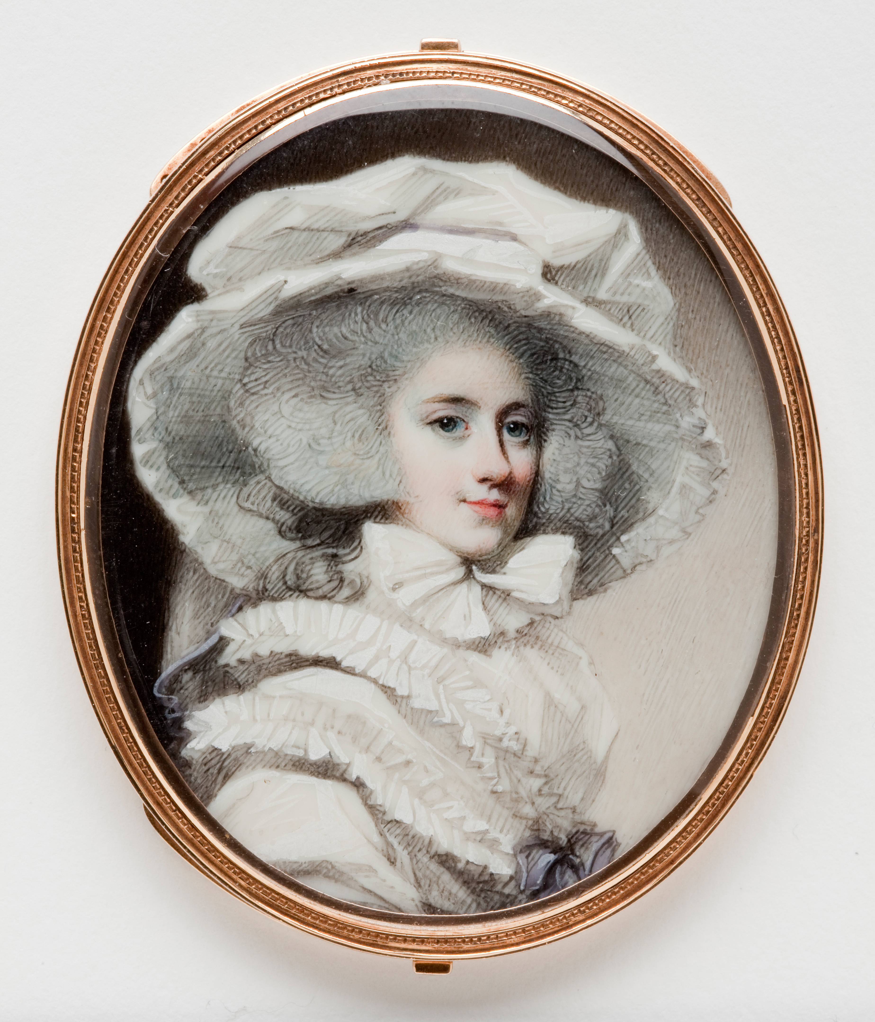 George Engleheart (English, 1750-1829), Woman in a Hat, ca. 1785/90. Watercolor on ivory in gold bracelet mount. 2 1/2 x 2 1/8 in. Milwaukee Art Museum, Gift of Edith Maclay in memory of Frederick H. von Schleinitz M2010.18. Photo credit: John R. Glembin.