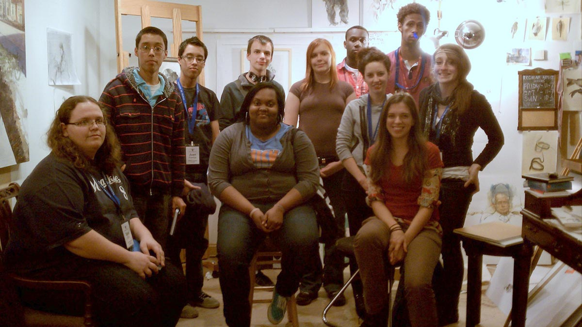 The Satellite students and Katie (bottom row, right)