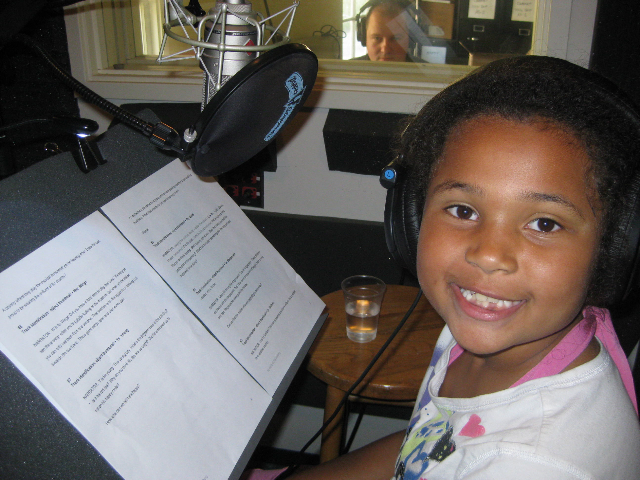 """Ayiana is hard at work recording the """"A is for Art"""" tour. Photo by Sandy Goldberg."""