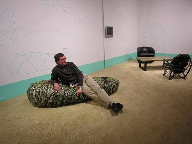 Jon Prown, Executive Director of Chipstone, sitting on Tanya Aguiñiga's Rock Sofa