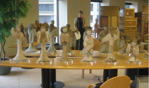 Janet Gourley photographing Han Dynasty dancers in the Conley collection, Fall semester 2005