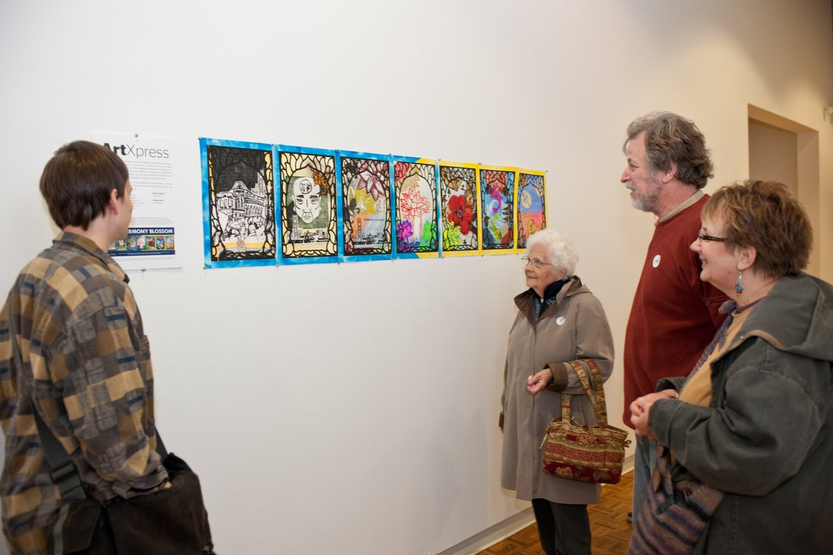 Marco and his family admire the installation of their original work on view in the Museum's Education Hallway. It's on view till January; come visit and check it out! Photo by Mark Hines