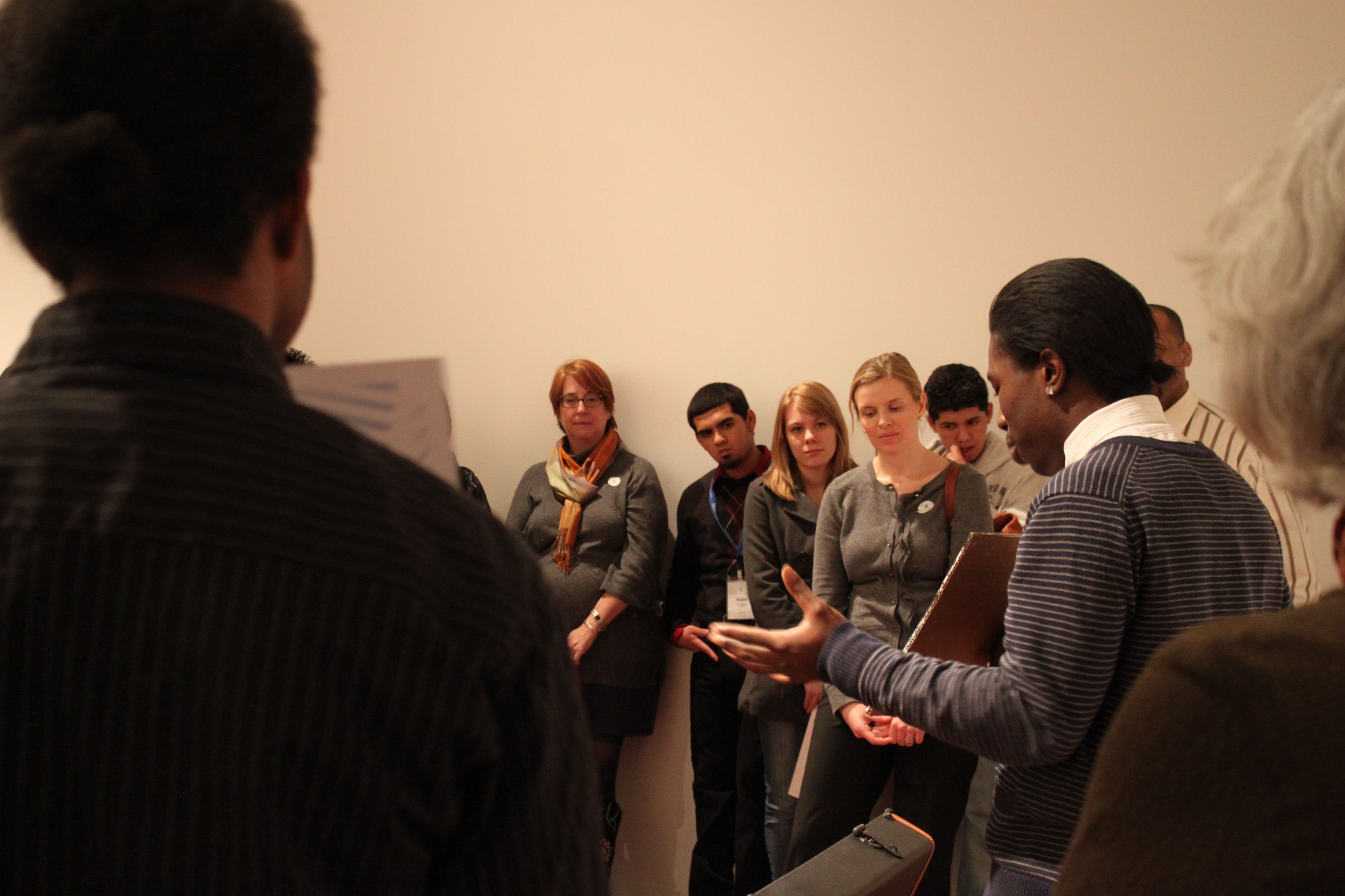 """Donnie gives his presentation on Robert Gober's """"Untitled."""" He created a painting and poem in response to the work."""