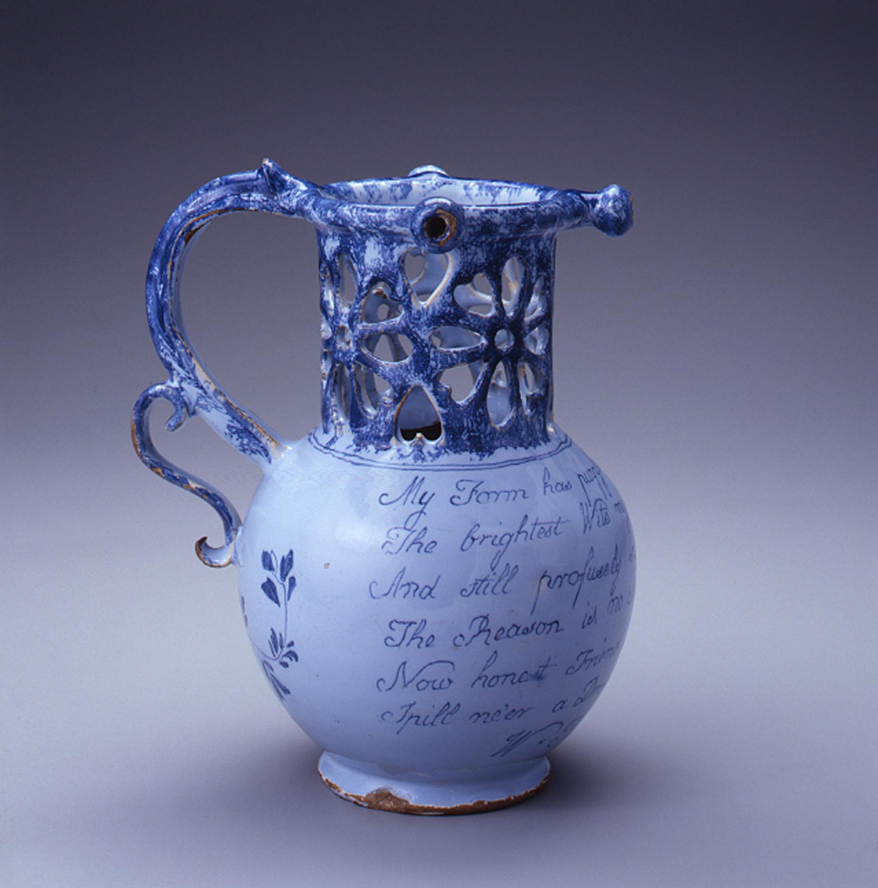 Puzzle Jug, 1771. Bristol, England. Buff earthenware/Bluish-white tin glaze. Chipstone Foundation Collection; Photo by Gavin Ashworth