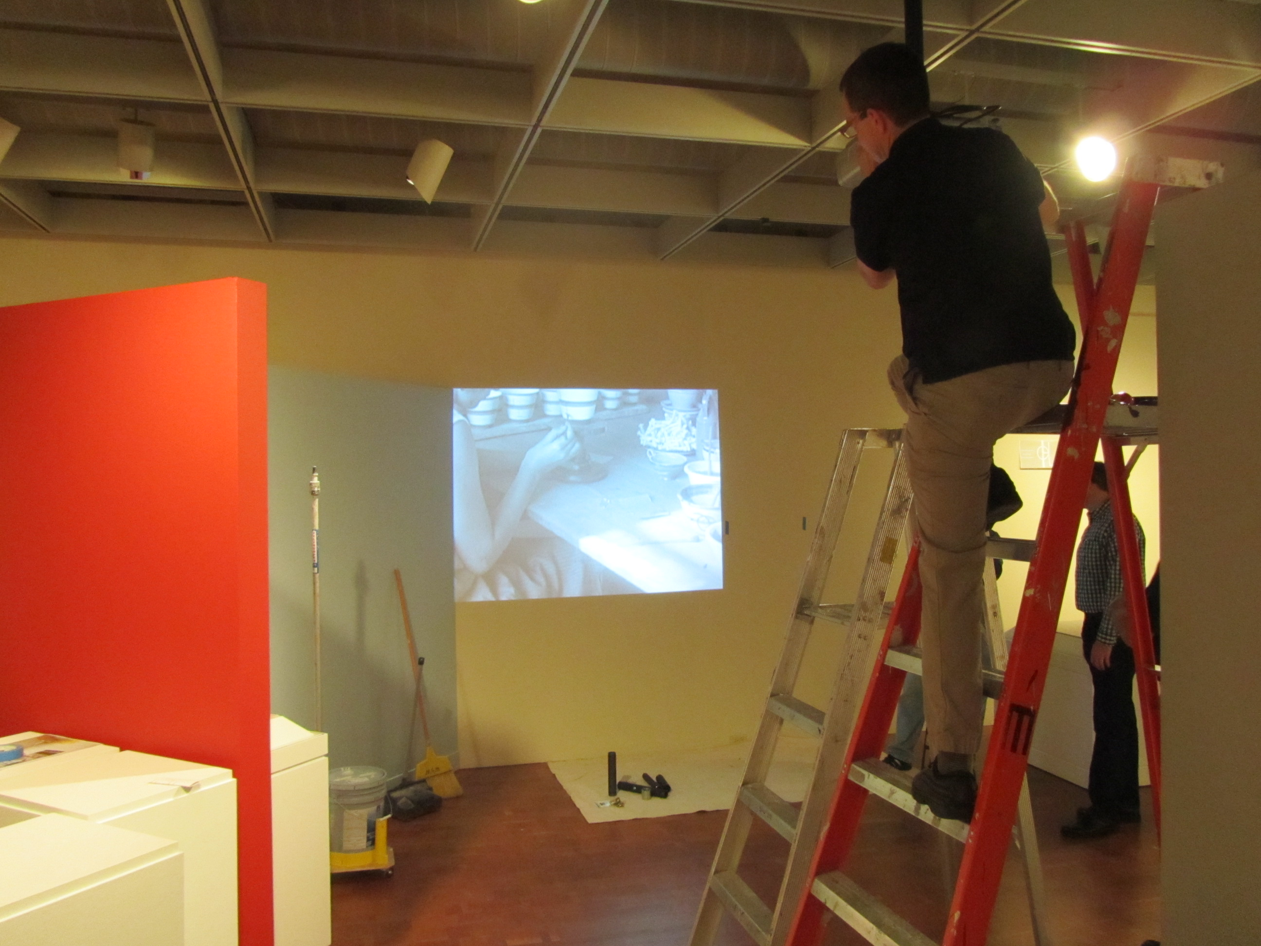 The Museum's A/V techTed Brusubardis installs video equipment. Photo by the author.
