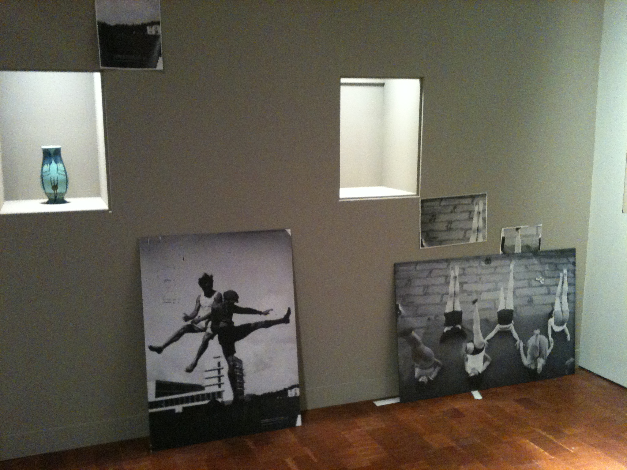 During installation photo. Two photo reproductions used as supportive materials are leaned against the wall. With two framed artworks and an additional vase, the entire wall will make a composition. Photo by the author.