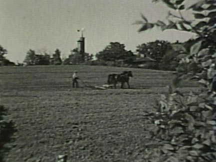 Film still: Tilling the fields at Taliesin, early 1930s. Milwaukee Art Museum, Institutional Archives.