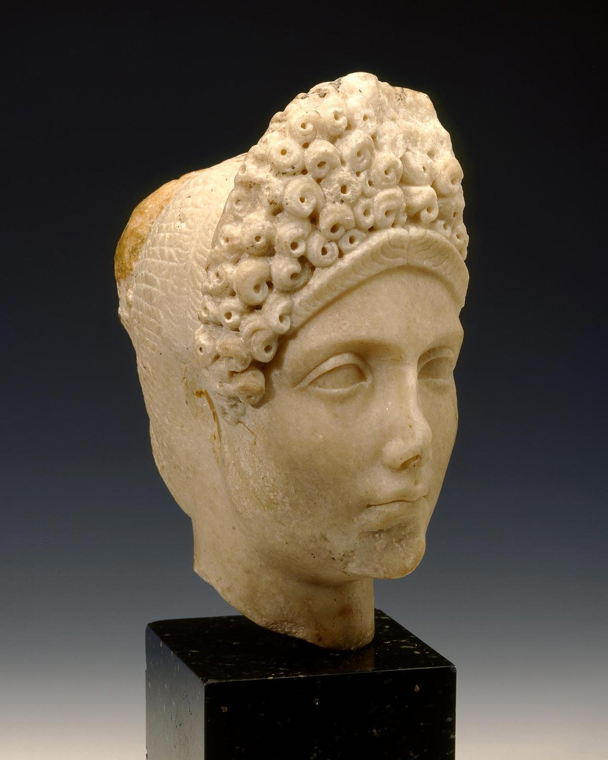 Bust of a noble woman made of tan marble