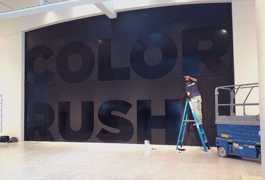 Sign-a-Rama installing the vinyl onto our glass wall