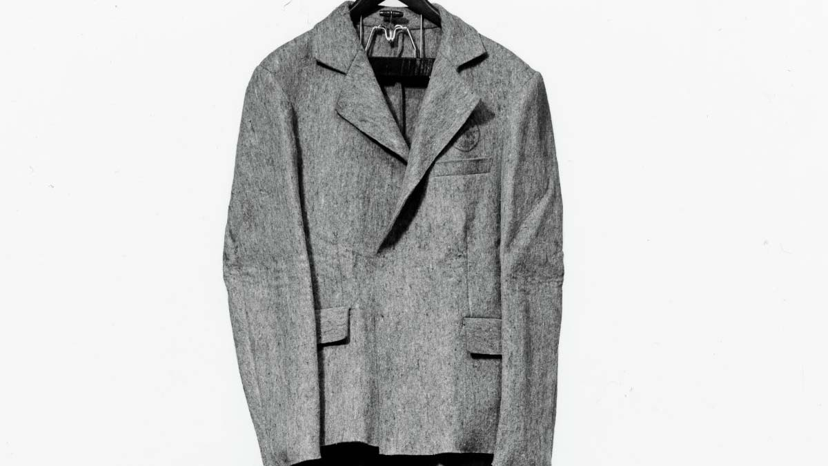 Gray felt suit on a hanger