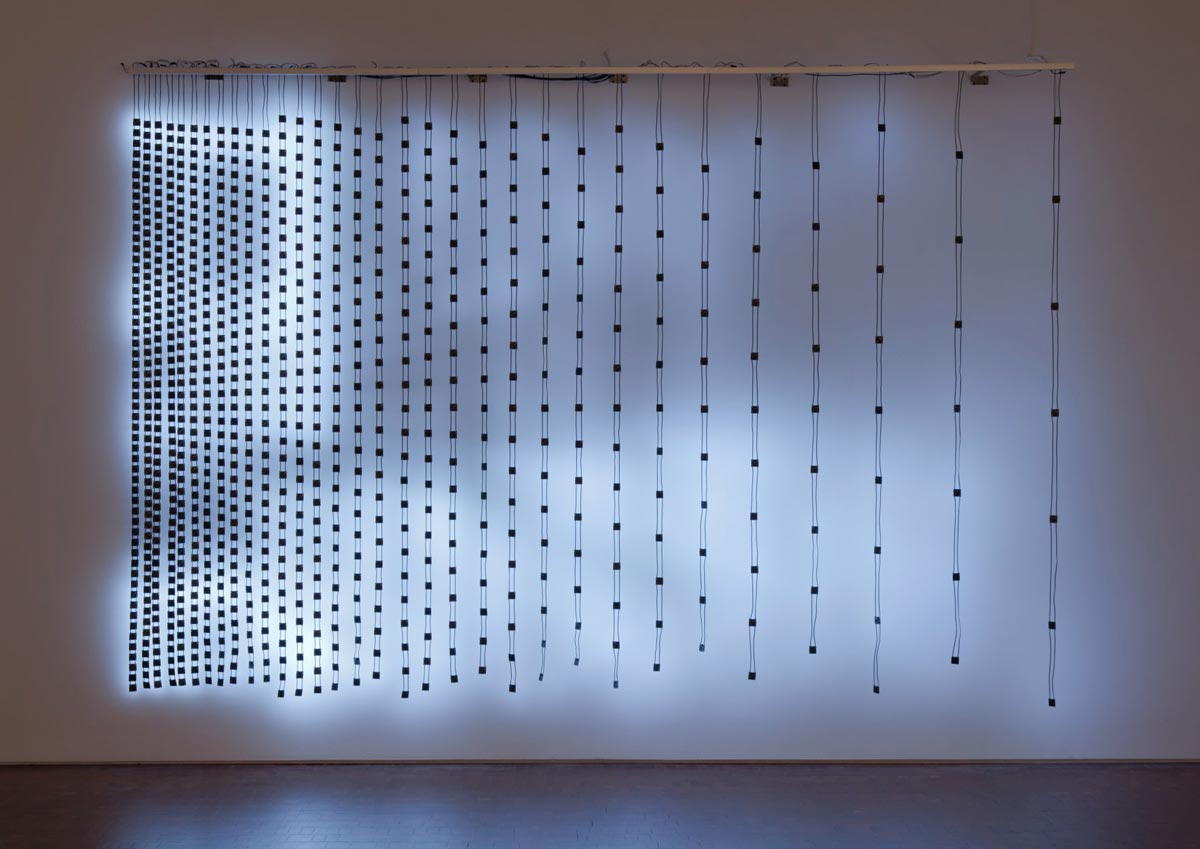 Illuminated wires with square blocks that start densely packed on the left and slowly get more sparse