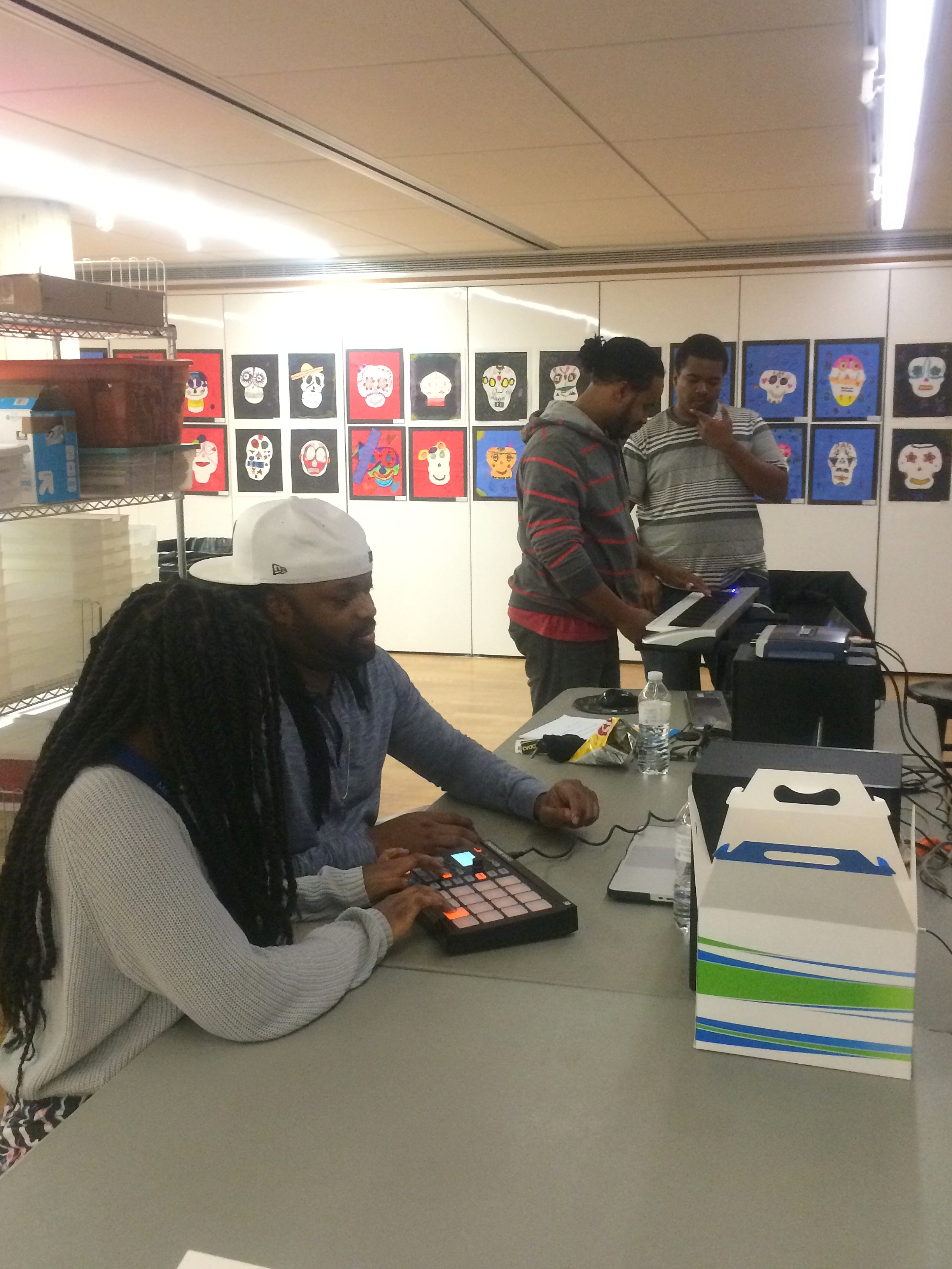 Zakia and Daiveon work with Dwight and Marquis Gilbert from H2O Music Milwaukee to create hip-hop music inspired by Salvator Rosa. Photo by Chelsea Emelie Kelly