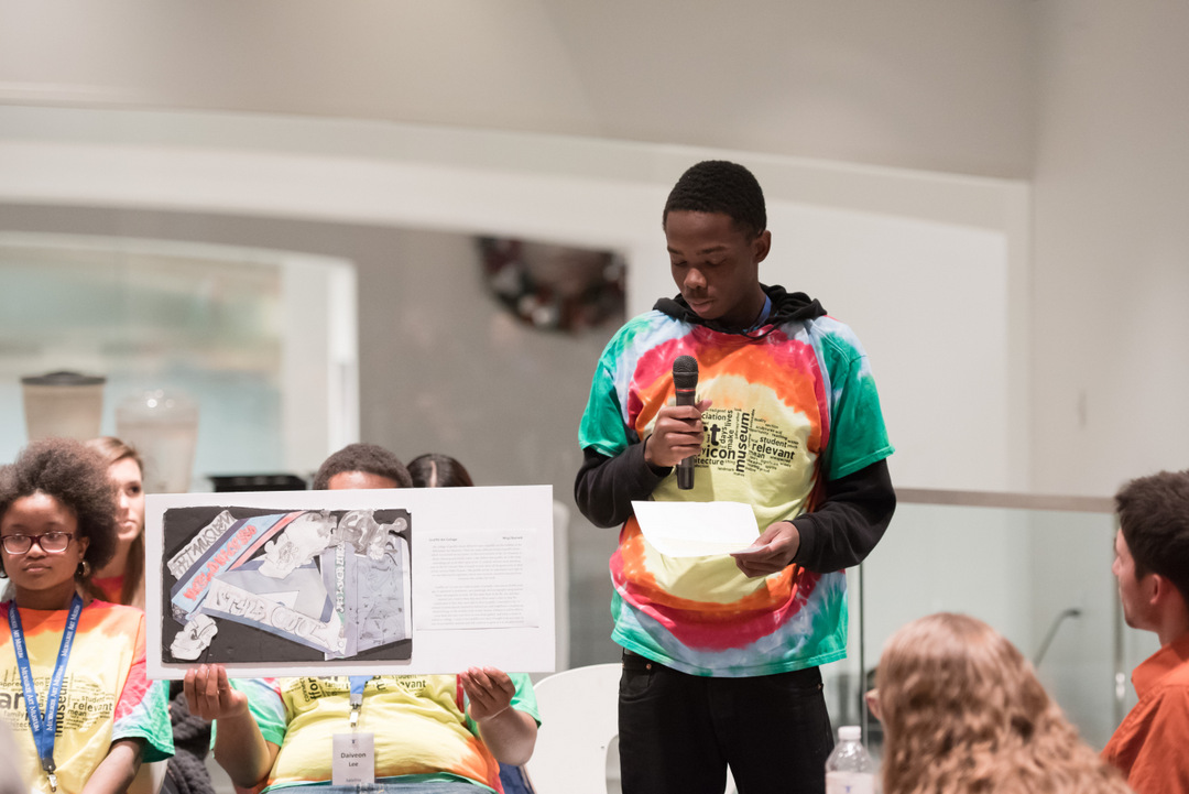 Nhyji talks about his final project. Photo by Front Room Photography