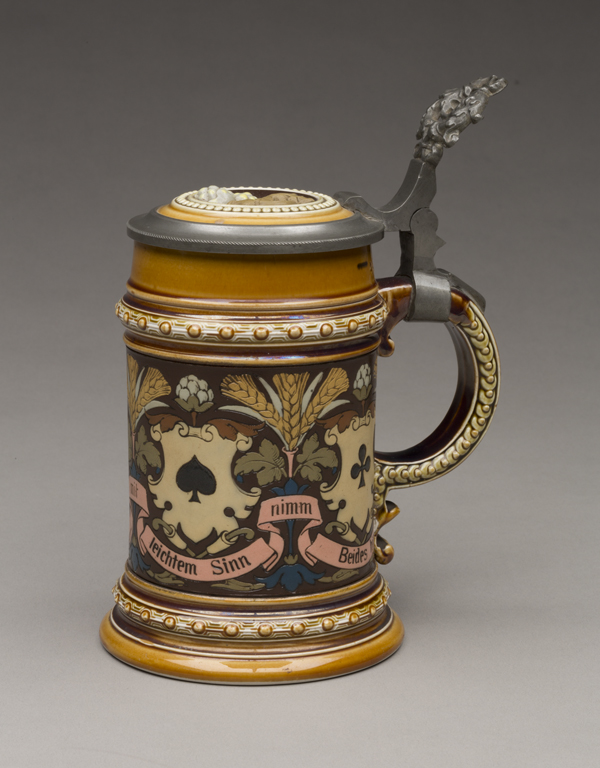 """Villeroy & Boch (Mettlach, Saarland, Germany, established 1836), designed by Christian Warth (German, active 1854–1892). """"1395"""" Stein, 1885. Stoneware with colored slip and glaze decoration, gilding and pewter. Milwaukee Art Museum, Bequest of Dorothy Trommel in memory of her parents, Eunice and Howard Wertenberg M2013.43.  Photo credit: John Glembin."""