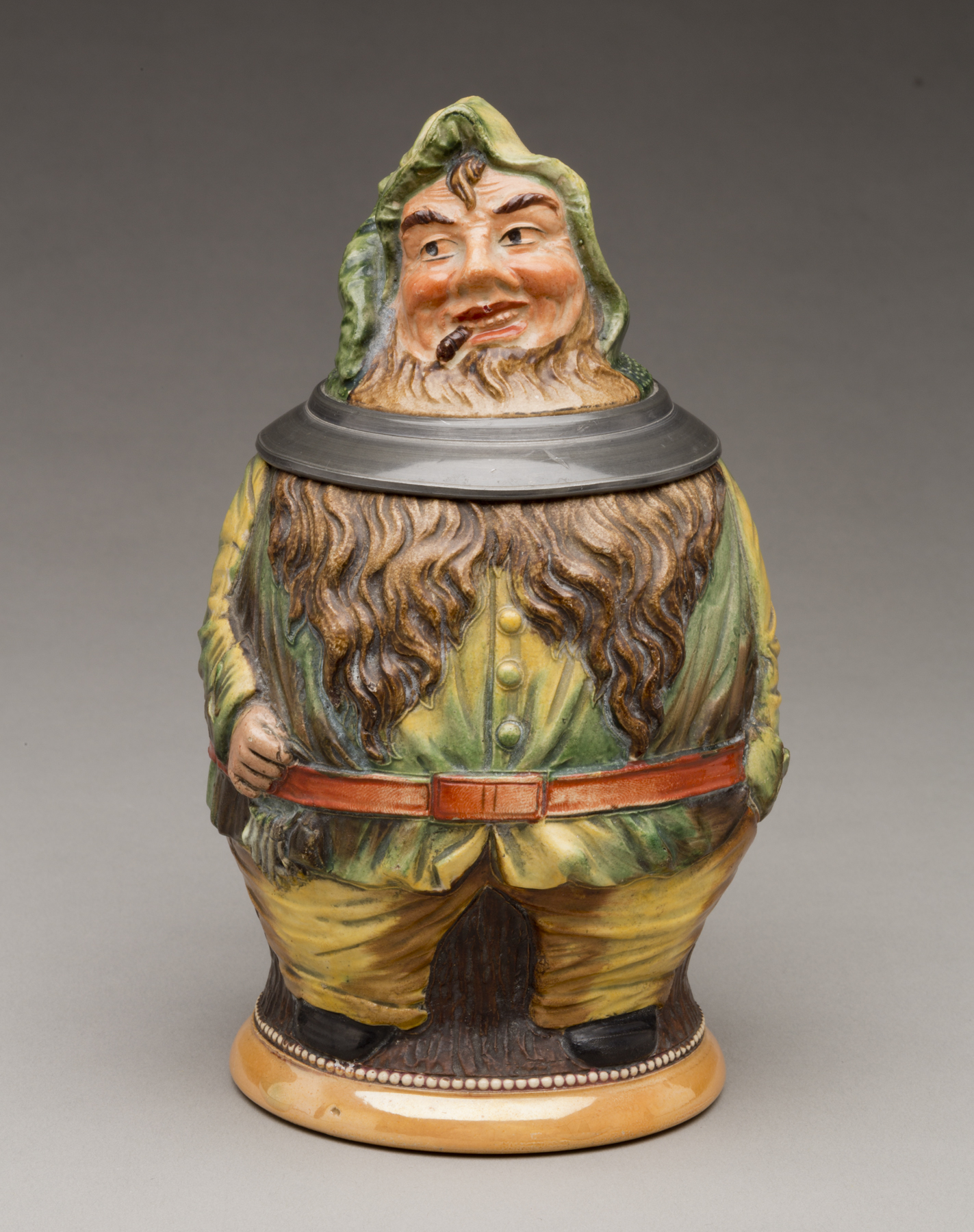 """German. """"Elf"""" Stein, ca. 1900. Earthenware with colored slip and glaze decoration, and pewter. Milwaukee Art Museum, Bequest of Dorothy Trommel in memory of her parents, Eunice and Howard Wertenberg M2013.44. Photo by John R. Glembin."""