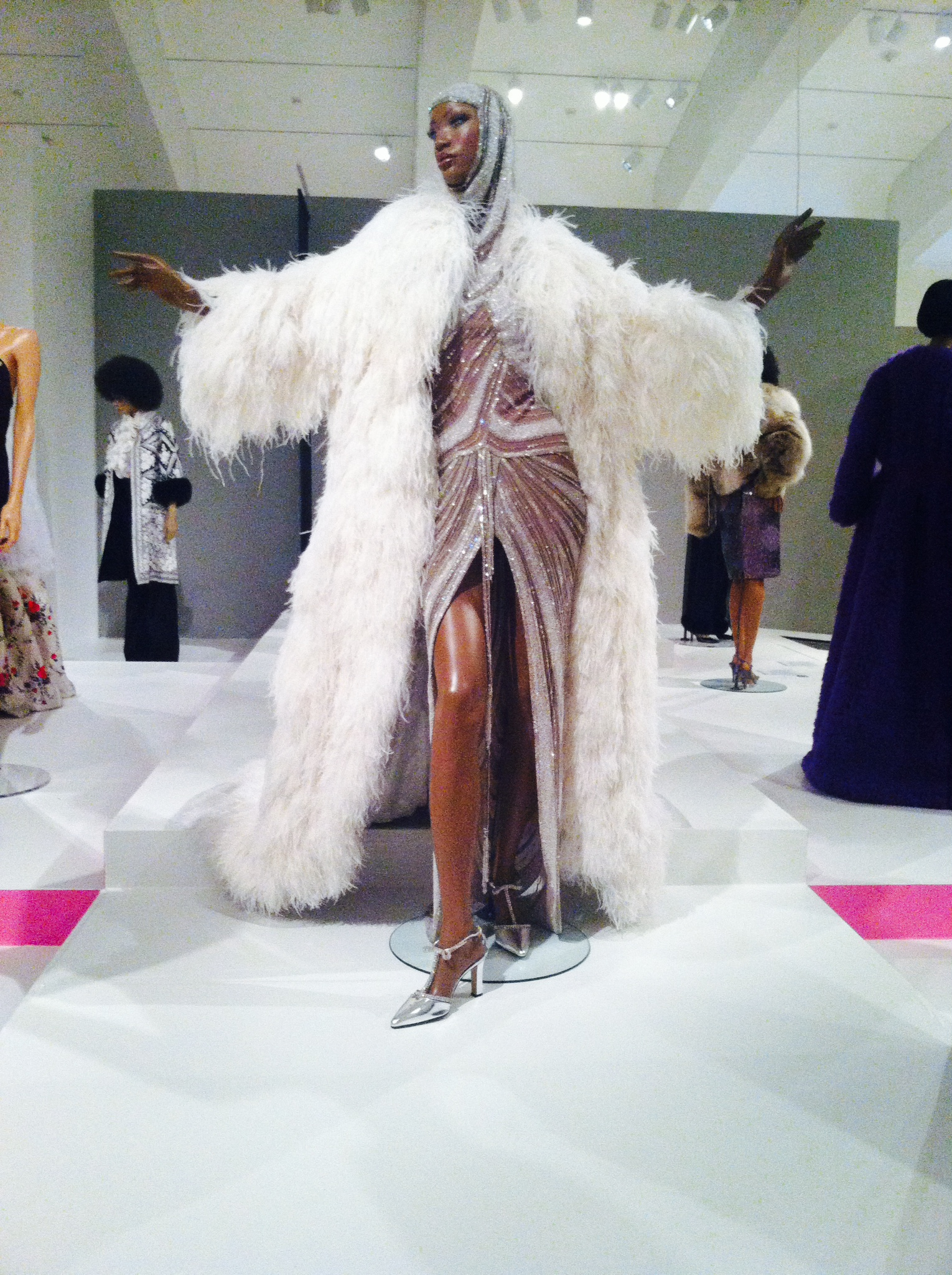 This dazzling evening ensemble, designed by Bob Mackie, can be found in the 'Power' portion of the exhibit. Photo by Emma Wallo