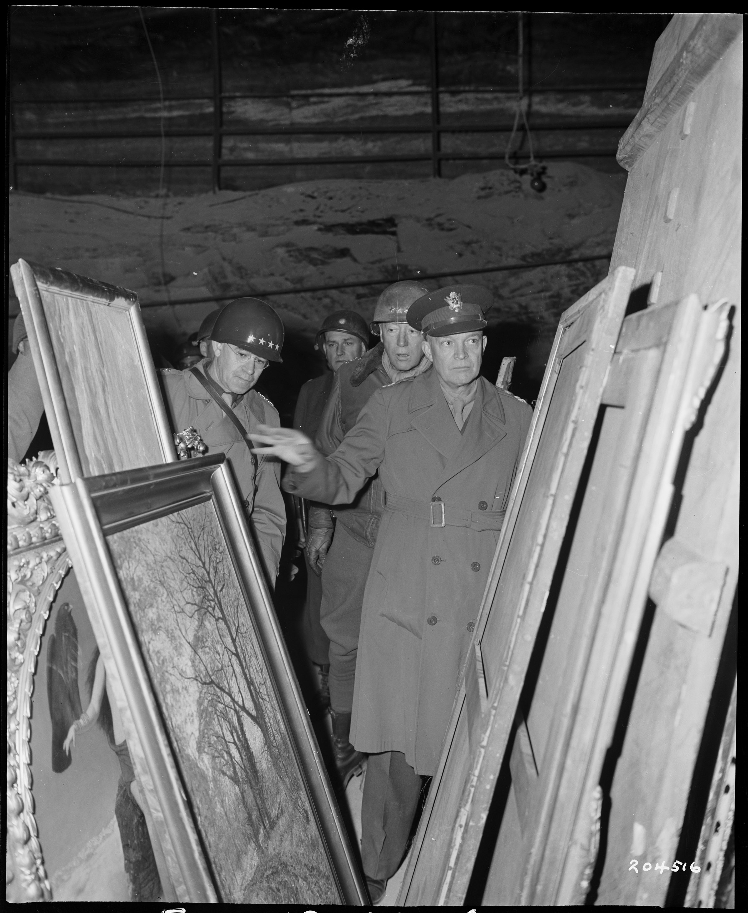 General Dwight D Eisenhower, Supreme Allied commander, inspects art treasures looted by the Germans and stored away in the Merkers salt mine. National Archives RG 111-SC-204516.