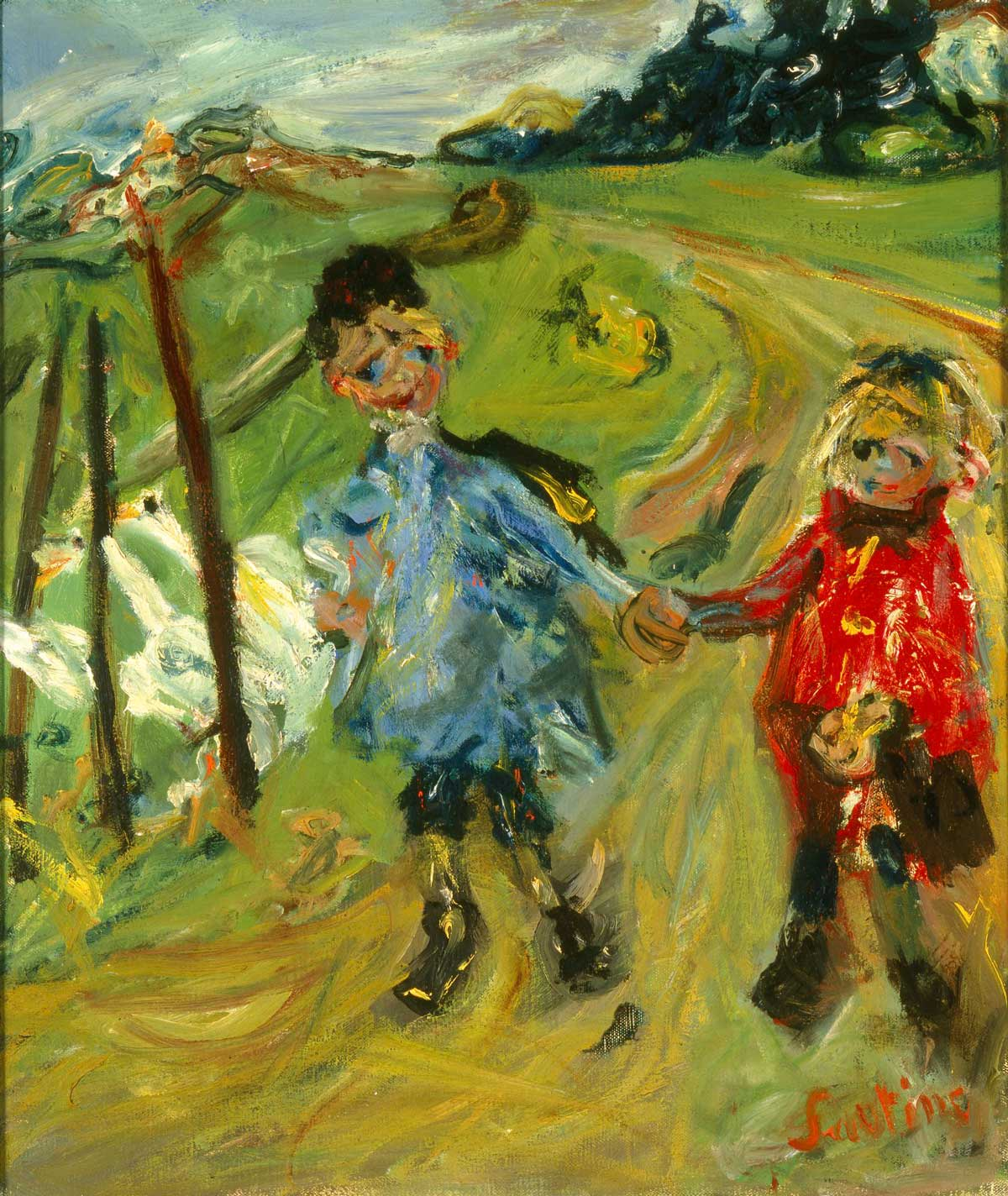 Two young children walking in a field