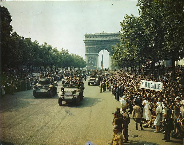 Crowds of French patriots line the Champs Elysees to view Allied tanks and half tracks pass through the Arc du Triomphe, after Paris was liberated. Photograph by Jack Downey, courtesy of the Library of Congress, LC-USW36-1 A.