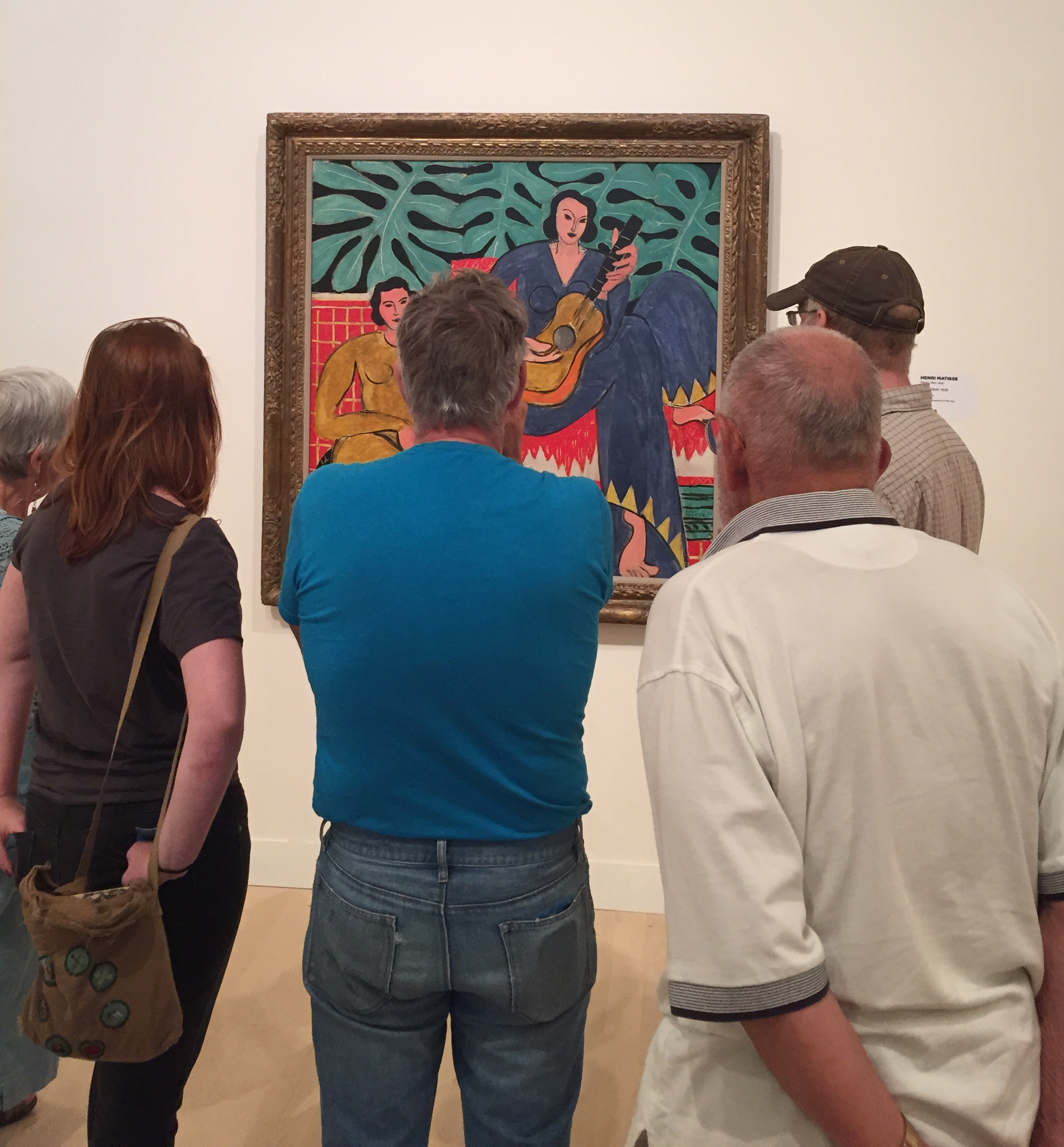 """Museum visitors enjoy Matisse's painting """"La Musique"""" which was on view this summer in the exhibition Van Gogh to Pollock: Modern Rebels. Photo by the author."""