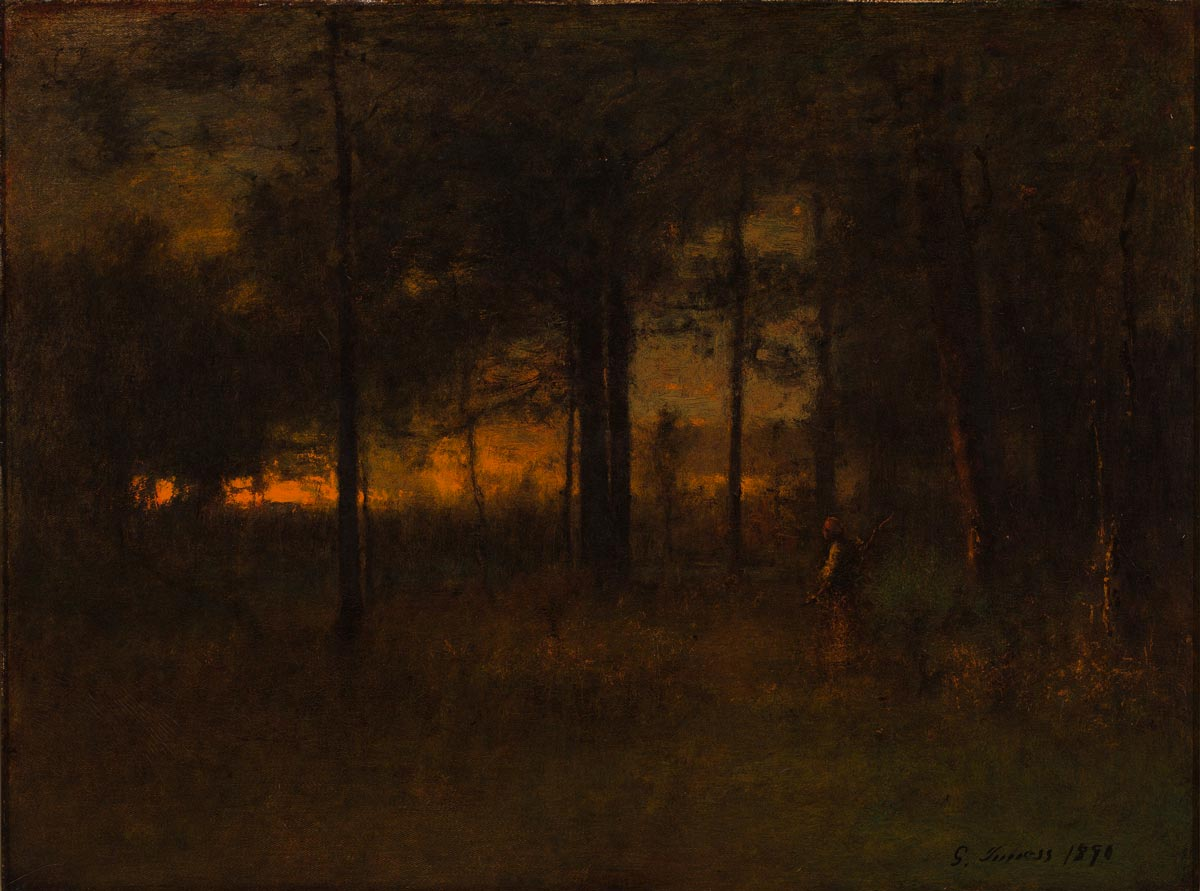 Woman standing among trees with the sunset peeking through