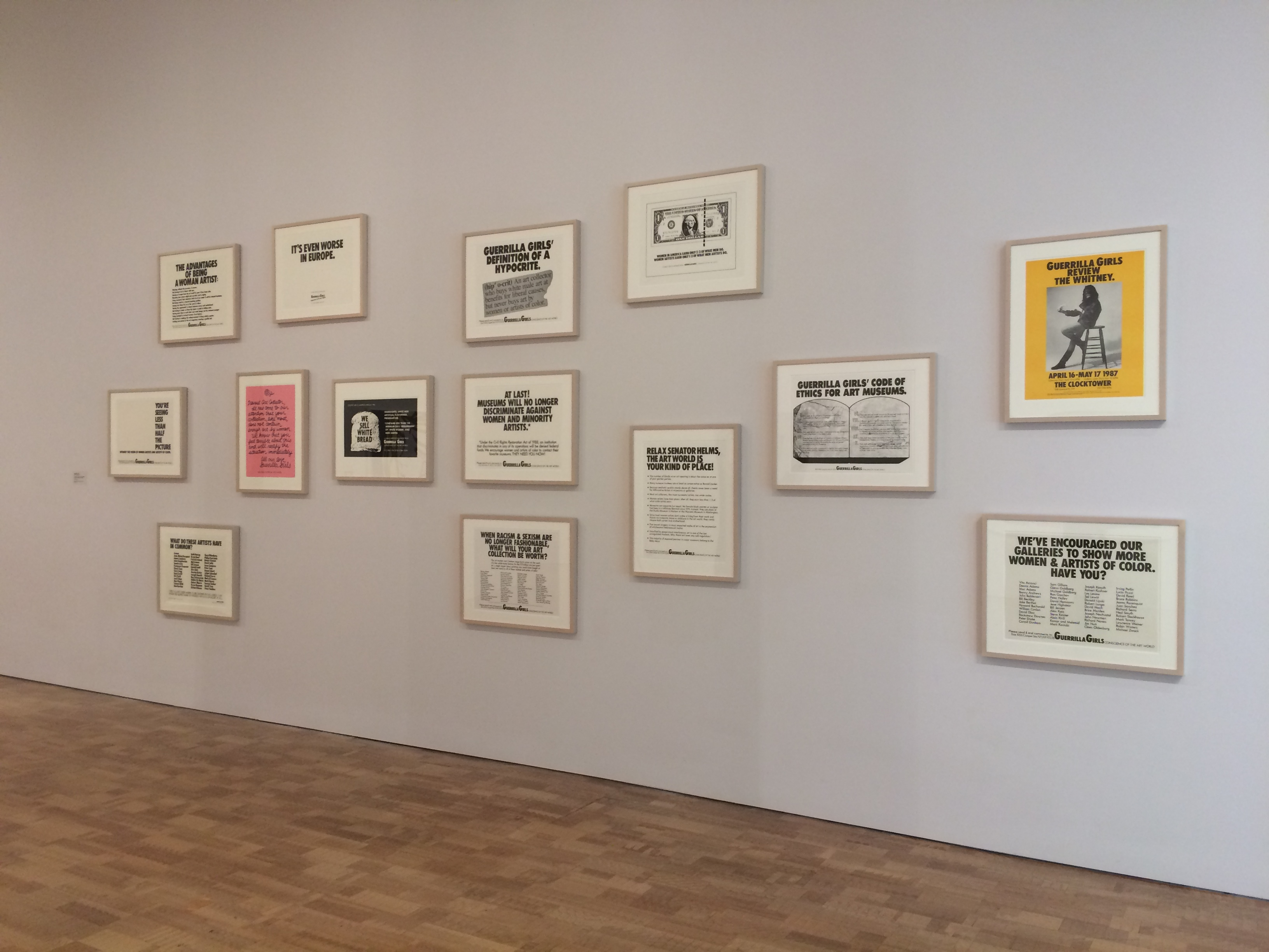 Installation of Guerrilla Girls prints at the Milwaukee Art Museum. Photo credit: Tina Schinabeck.