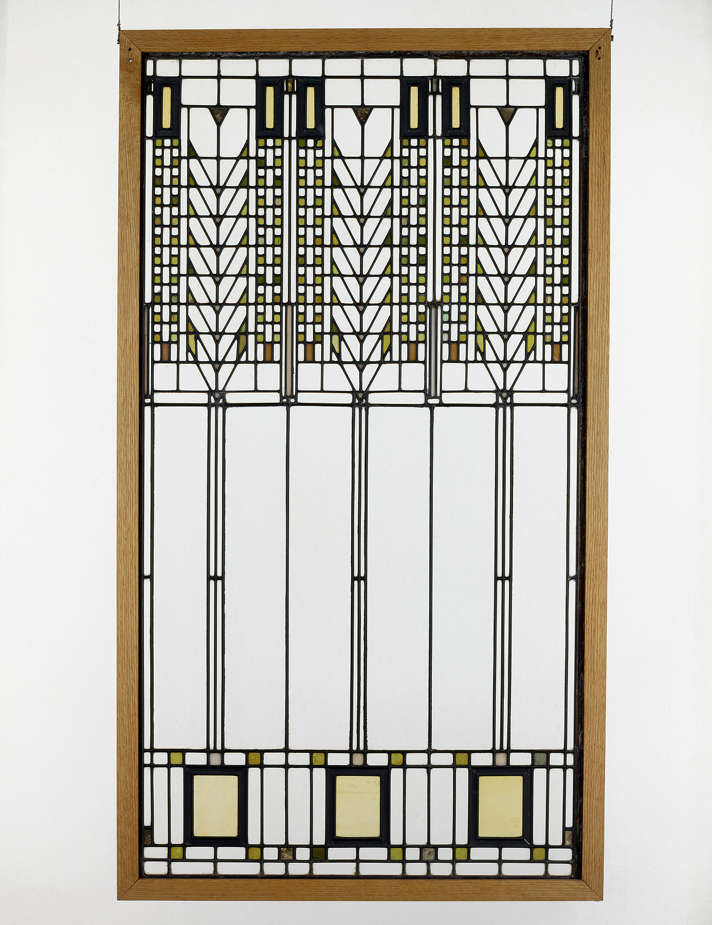 "Frank Lloyd Wright (American, 1867–1959). ""Tree of Life"" Window from the Darwin D. Martin House (Buffalo, New York), 1904. Glass with zinc cames. Milwaukee Art Museum, Gift of the Frederick Layton Art League in memory of Miss Charlotte Partridge and Miss Miriam Frink M1978.262. Photo credit: Richard Beauchamp. © Frank Lloyd Wright Foundation."