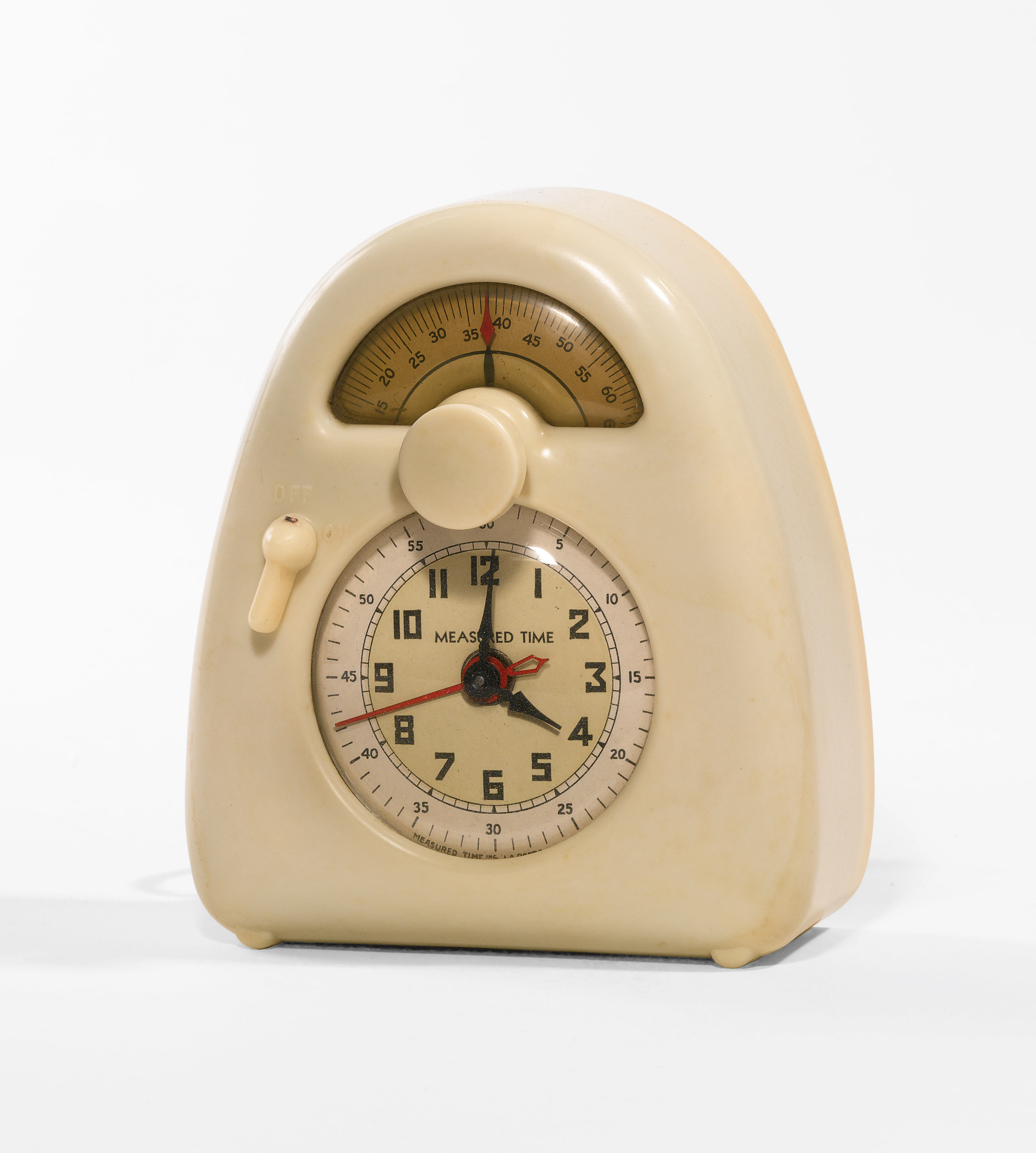 Isamu Noguchi for Measured Time, Inc., Clock and Kitchen Timer, ca. 1932. Bakelite, metal, glass, and painted metal. Gift from the George R. Kravis II Collection M2018.246. Photo: Sotheby's, © Sotheby's, Inc. 2016, © 2017 The Isamu Noguchi Foundation and Garden Museum, New York / Artists Rights Society (ARS), New York.