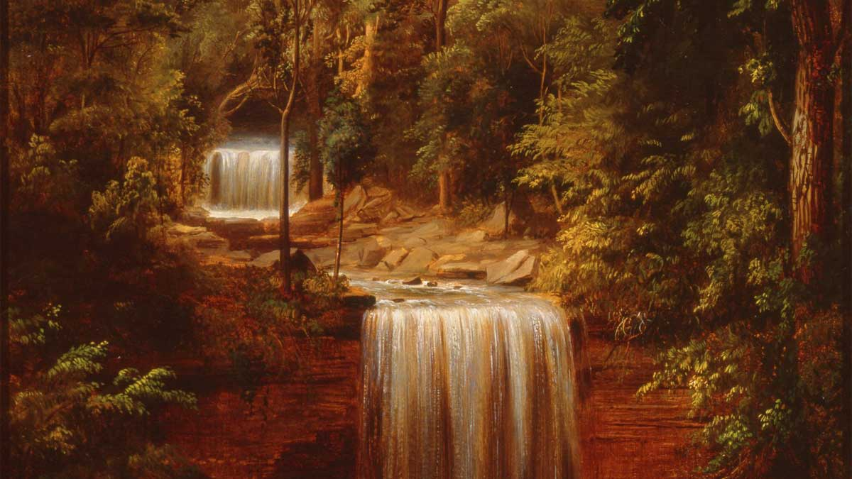 Waterfalls between fall foliage