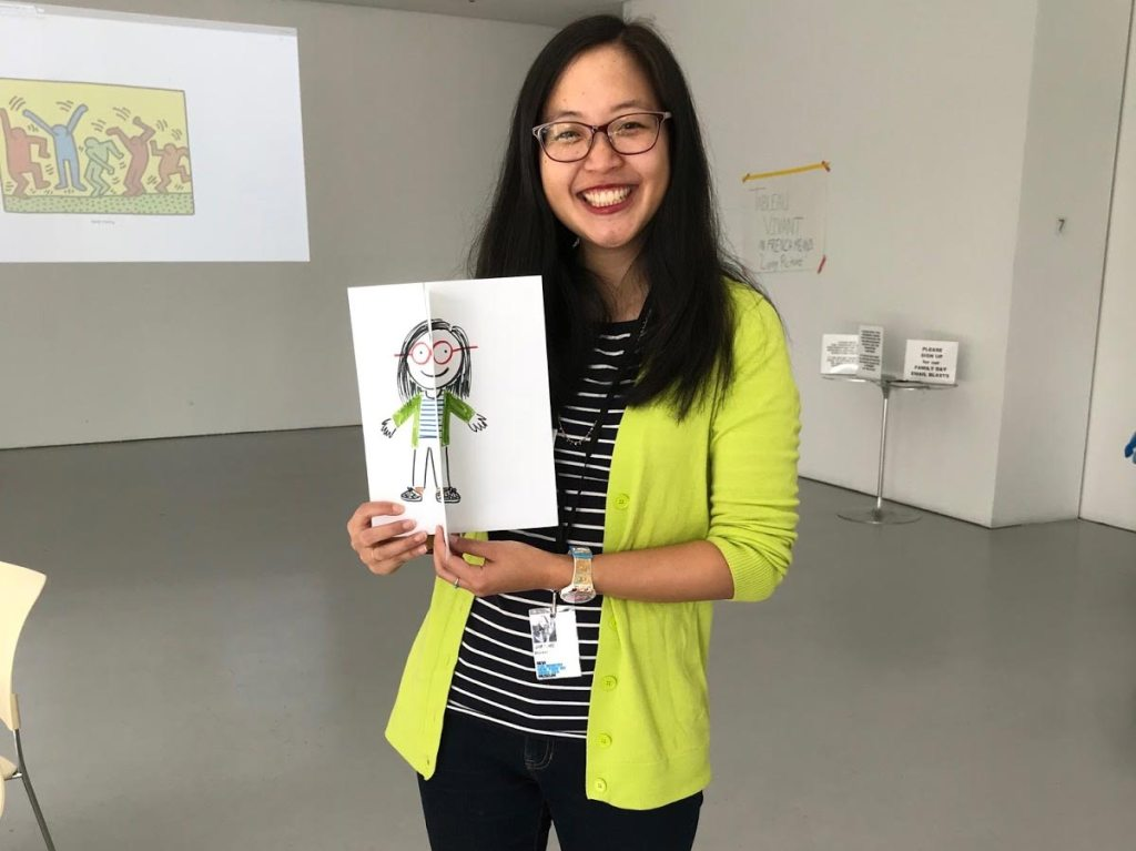Dianne Choie holding up a sketch