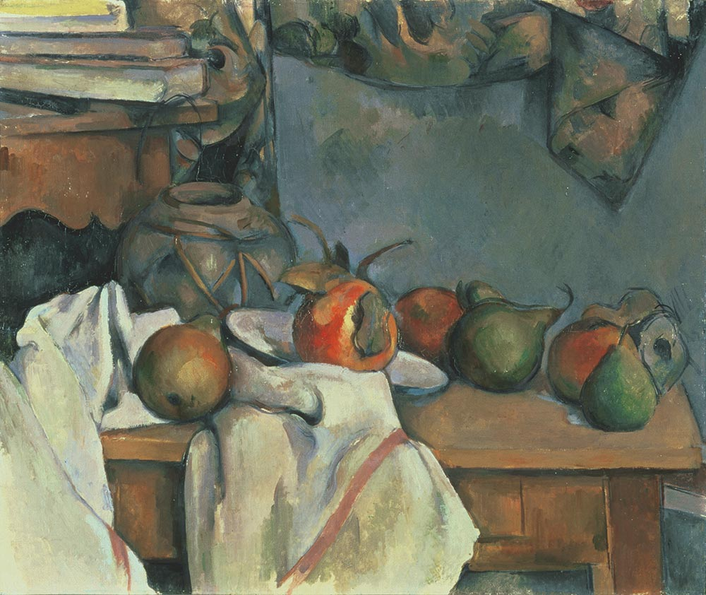 Fruit, flowers, and a white cloth on top of a wooden table
