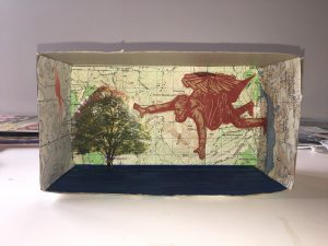 Tissue box with map glued to the back and different magazine cutouts on top