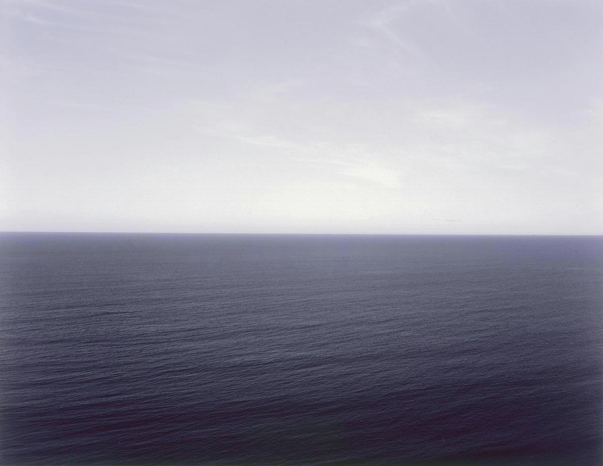 Open sea under a gray and blue sky