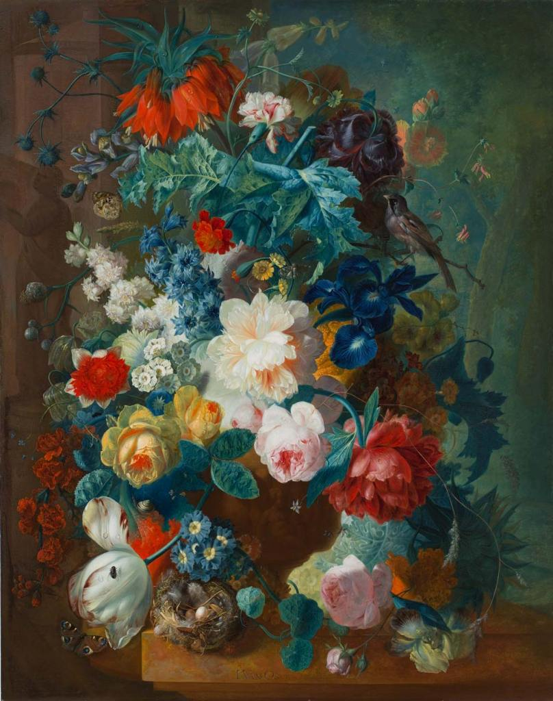 Multi-colored flowers overflowing in vase