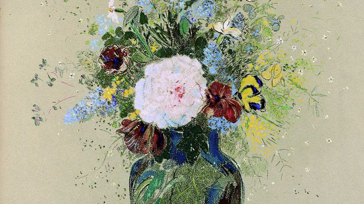 Multi-colored flowers in a blue vase