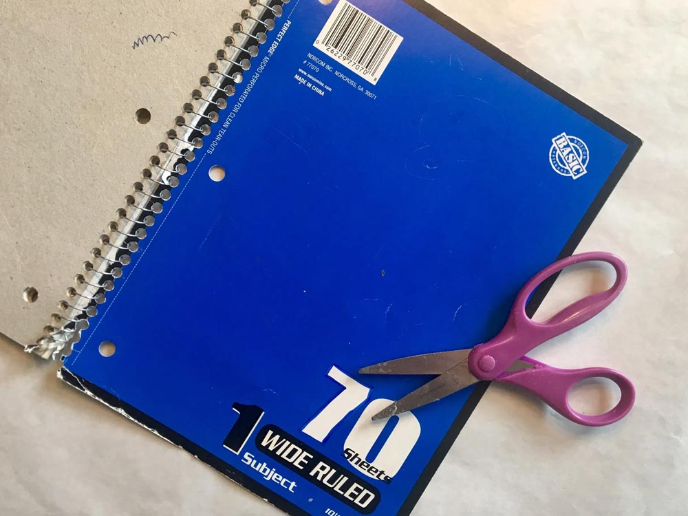 Blue spiral notebook and a pair of scissors