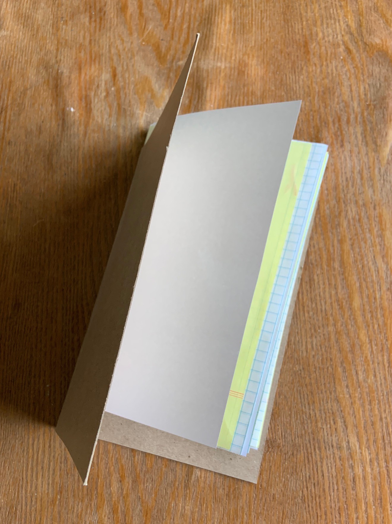 Different types of paper folded in half together
