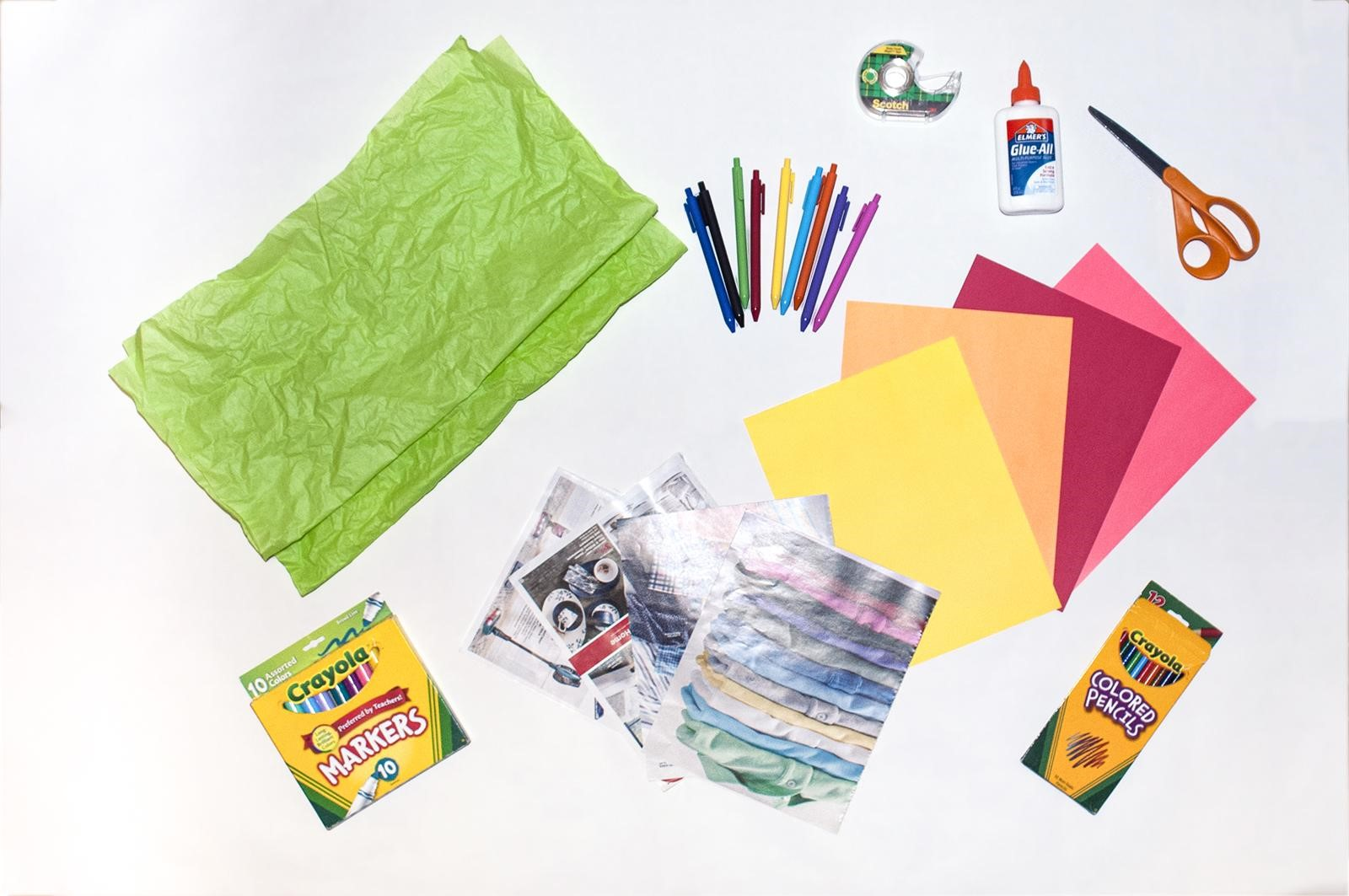 Art supplies including tissue paper, scissors, glue, colored paper, and markers,
