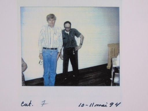 Artist Duane Hanson standing next to his Janitor sculpture