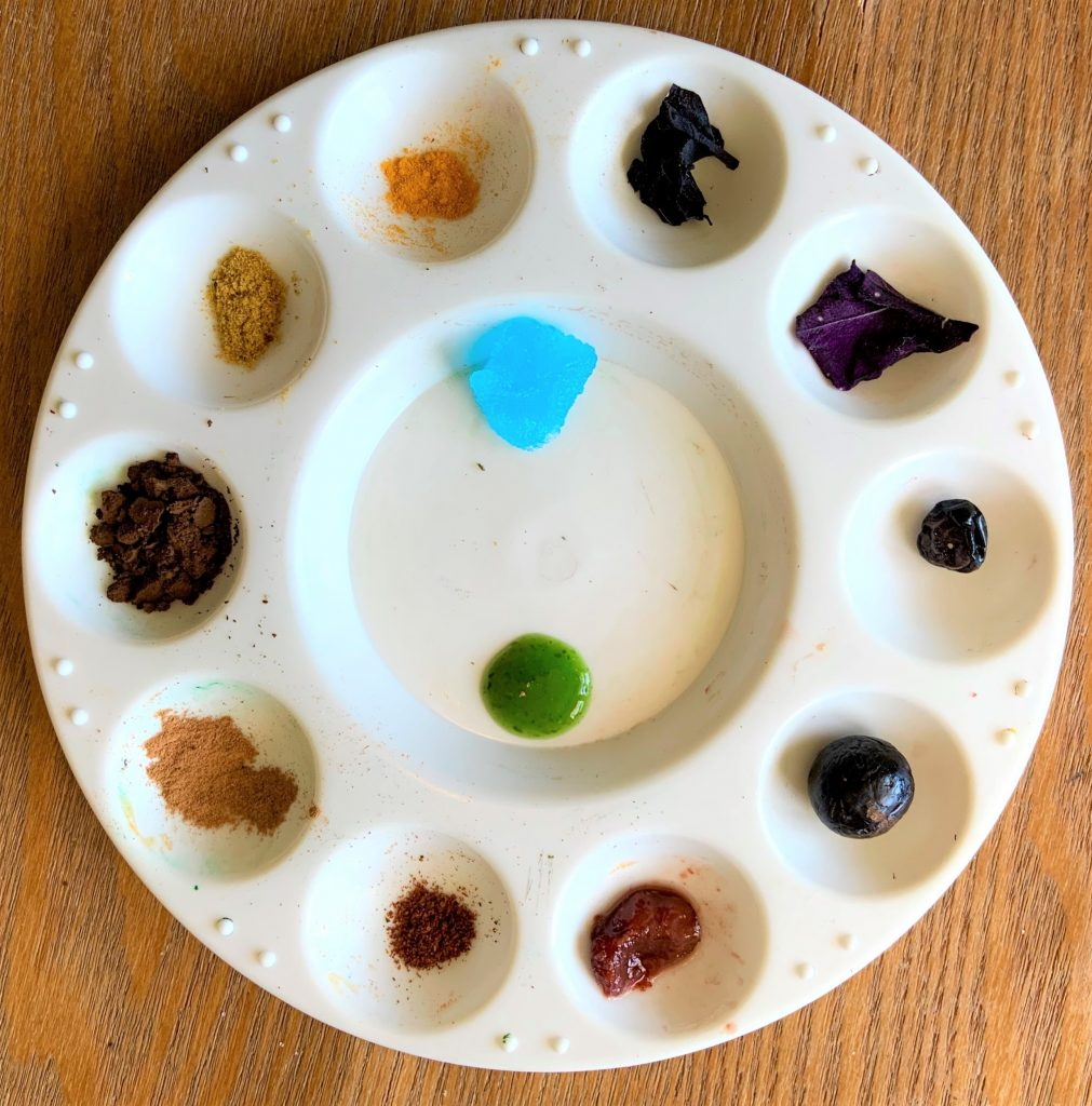 Pigments made of spices and juices on a plastic palette