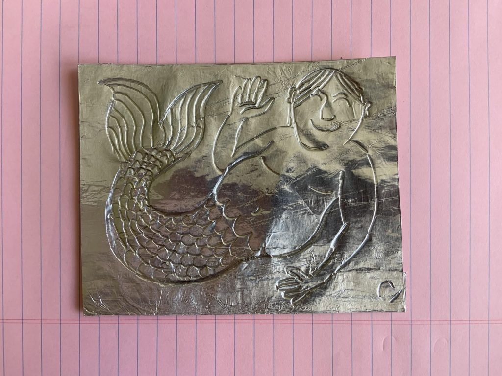 Sketch of a mermaid carved into a piece of foil