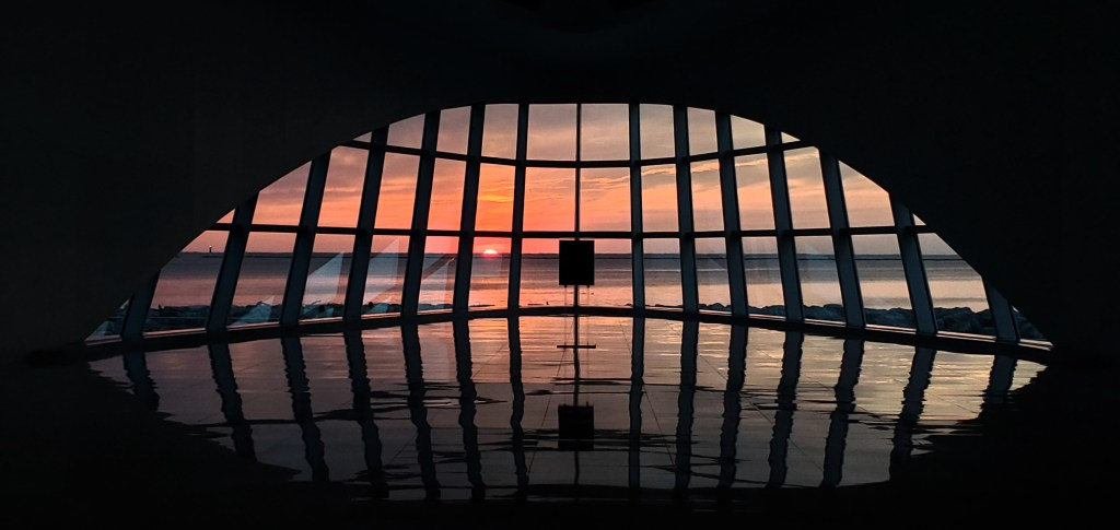 Sunrise peeking through the windows of Windhover Hall