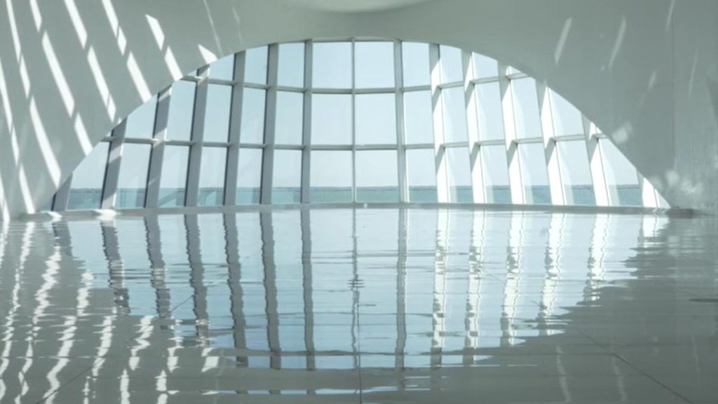 Water and sunshafts reflecting through Windhover Hall