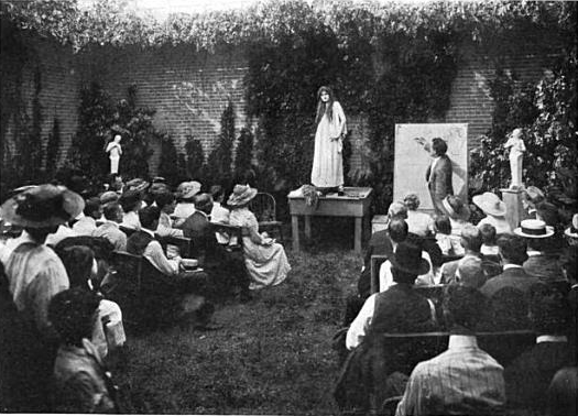 Woman giving a floral demonstration outside