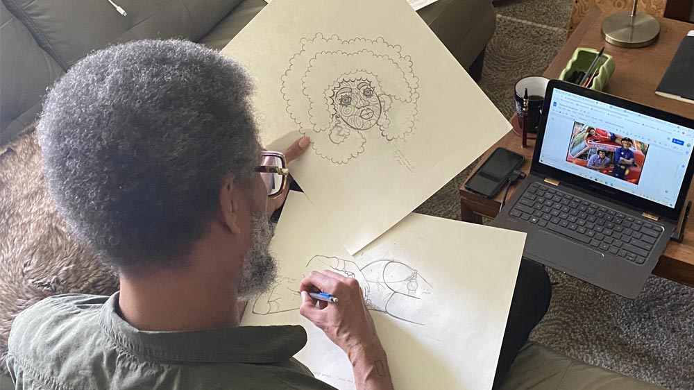 Man sketching a woman's head on paper