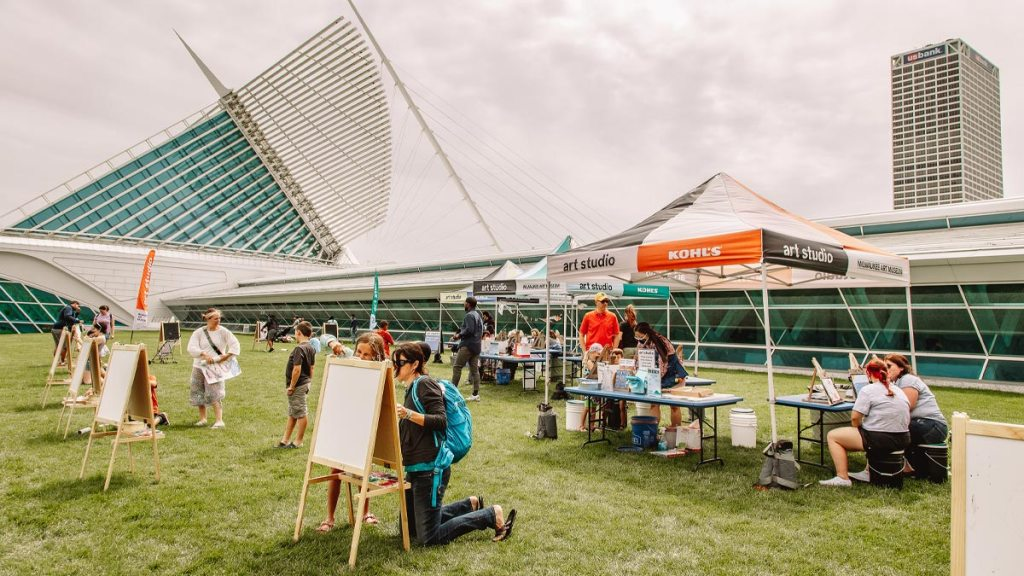 People creating art on easels along the lakefront